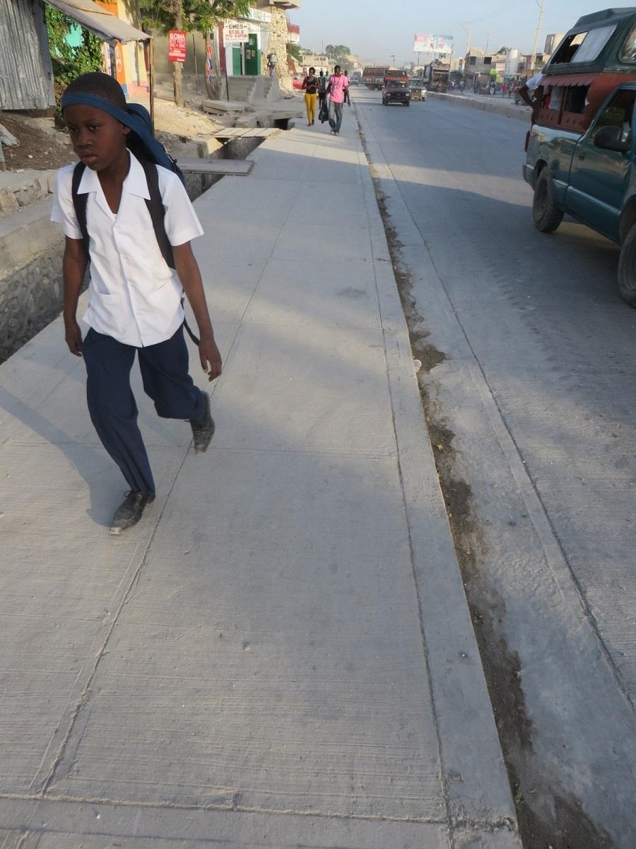 a boy walking in his school uniform