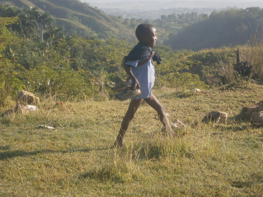 a boy carrying his school uniform pants