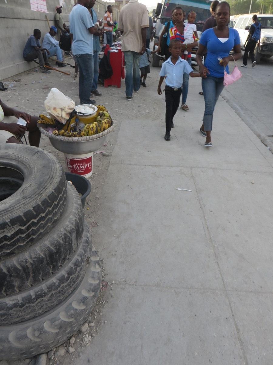 parent walking their child to school