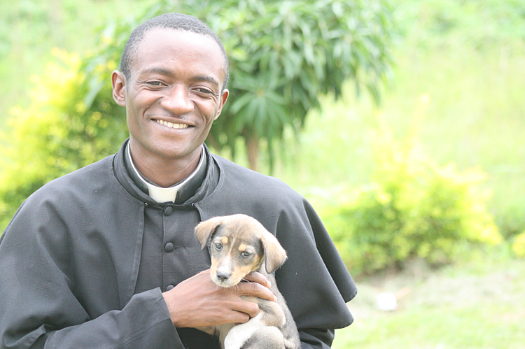 Fr. JohnBosco recently adopted a puppy, Polo, who was found outside of the CARITAS For Children Learning Center