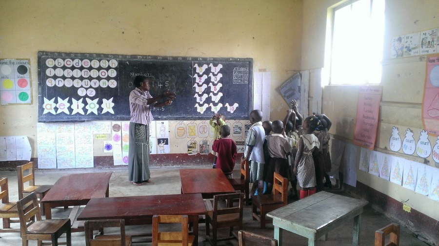 Teacher Grace guides the children at St. Anthony Pre-School through the morning lesson.