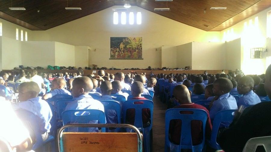 Eleven hundred boys at Catholic Mass on Sunday.