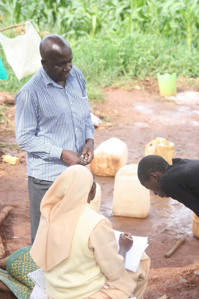 Sr. Carolyne with Location Coordinator Joseph Kkonde interviewing children for sponsorship