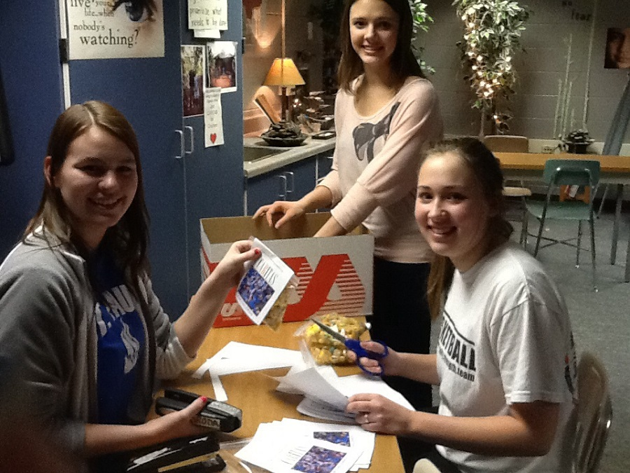 Students at Milton High School planning at bake sale for Allen's education