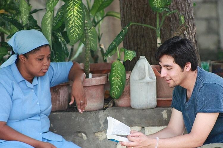 Juan, CARITAS For Children's Program Administrator, and a Little Sister share stories.