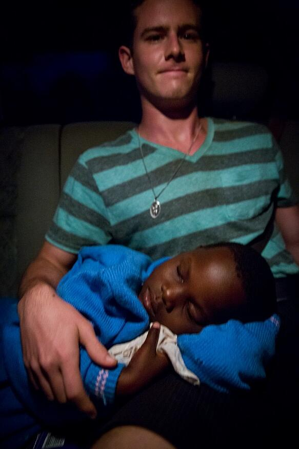 Child sleeping on adult's lap
