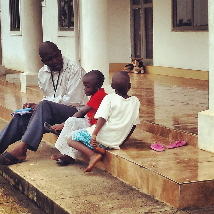 Joseph Kkonde, CARITAS' Coordinator in Uganda, interviewing two children for sponsorship