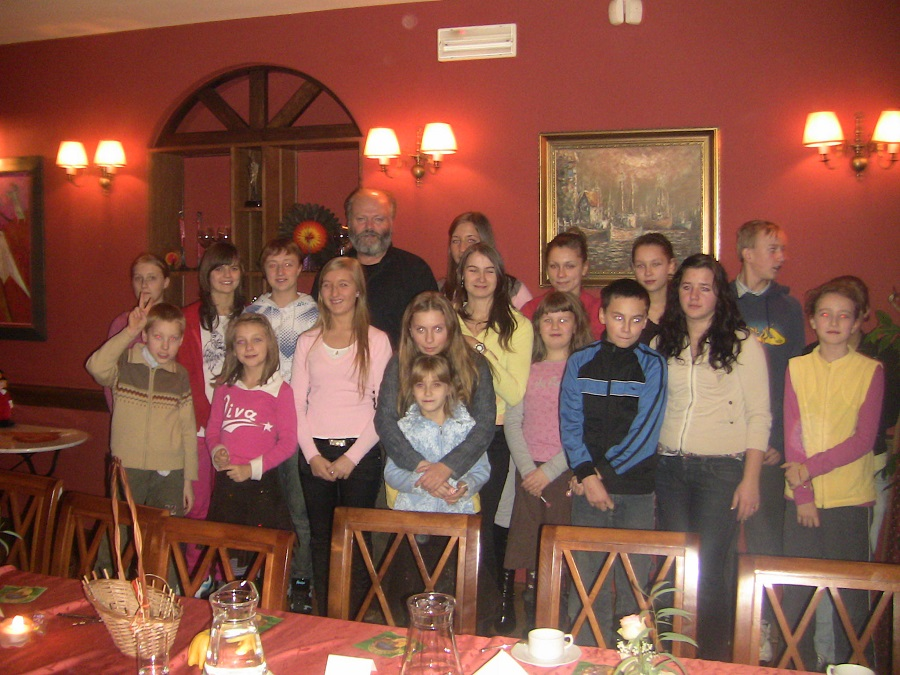 Christopher Hoar gathered with a group of children at a Polish orphanage.