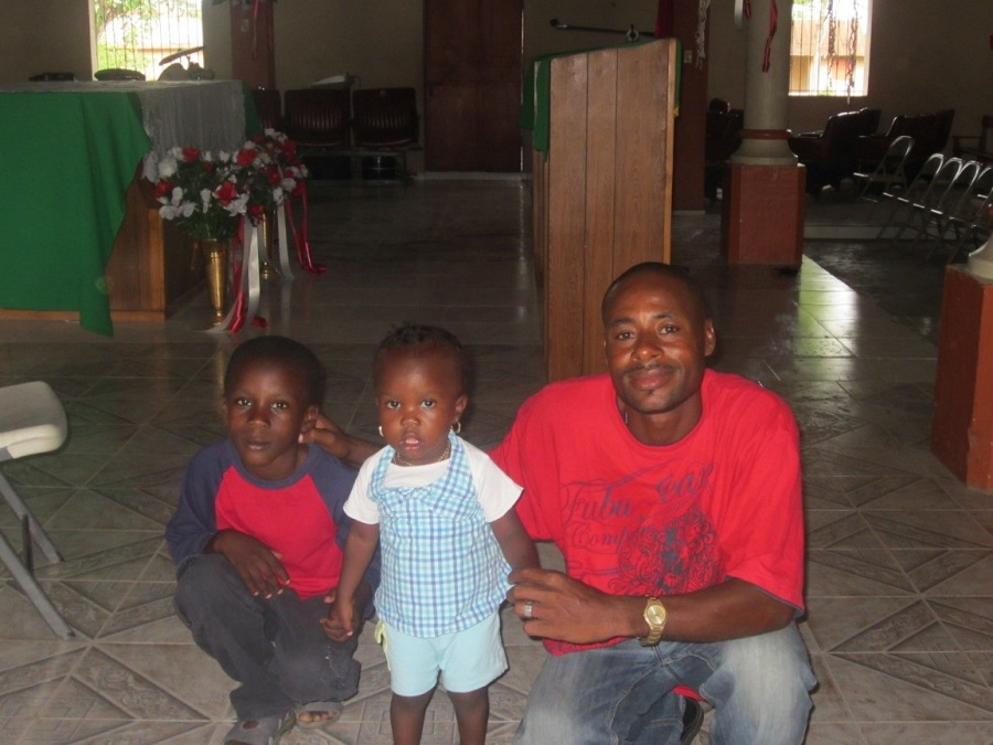A Haitian father with his two children
