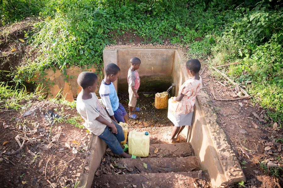 Filling jerry cans from a water pipe