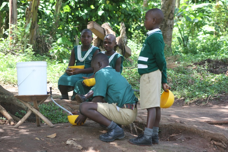 Dispensing clean water after it has been purified through the filter mechanism in the bottom of the bucket