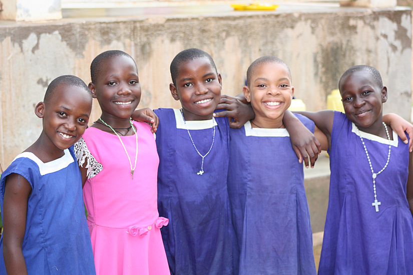 Cleire with her new friends at Stella Maris Boarding School