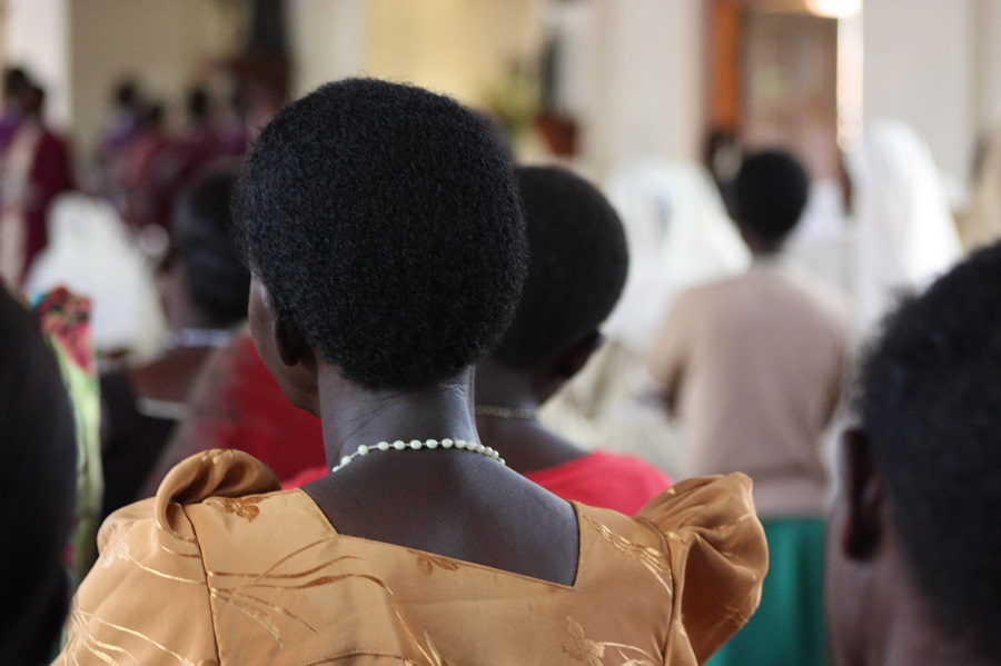 Women wore the traditional dressed-up Ugandan garb, called a gomas
