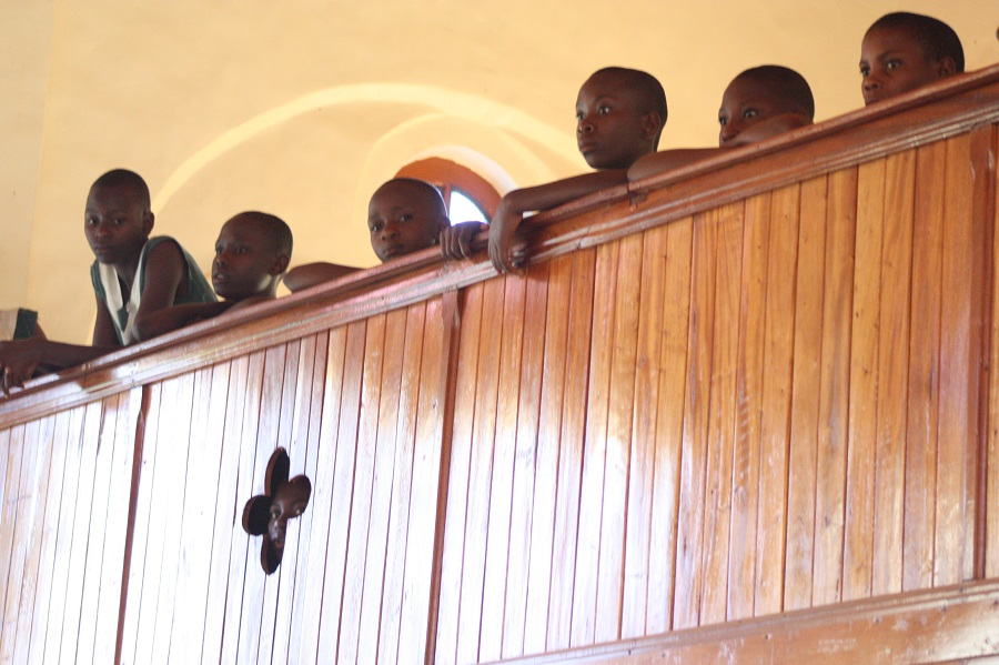 Children from St. Alphonsus Demonstration School, one of CARITAS For Children's partner schools, flow up to the balcony