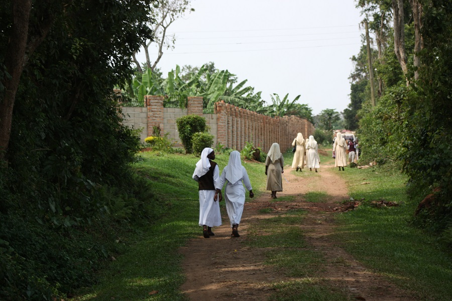 After the funeral, sisters walk home to resume their service in God's name