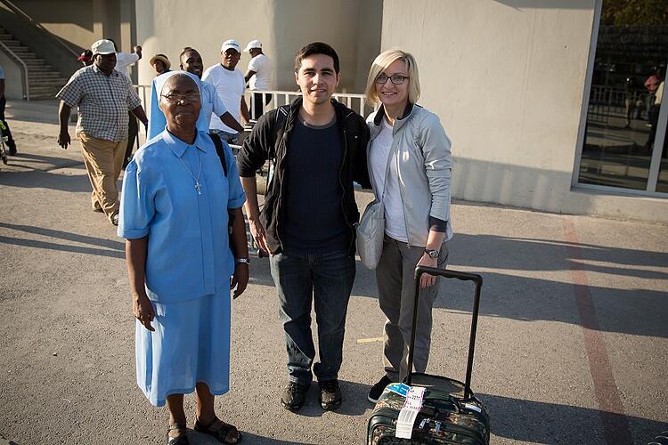 nun, non-profit employee and volunteer photographer posing for photograph