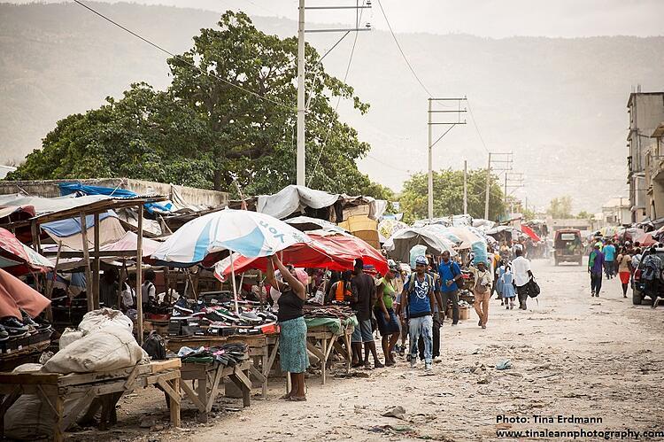 Street vendors under sun umbrellas on the streets of Port au Prince, Haiti