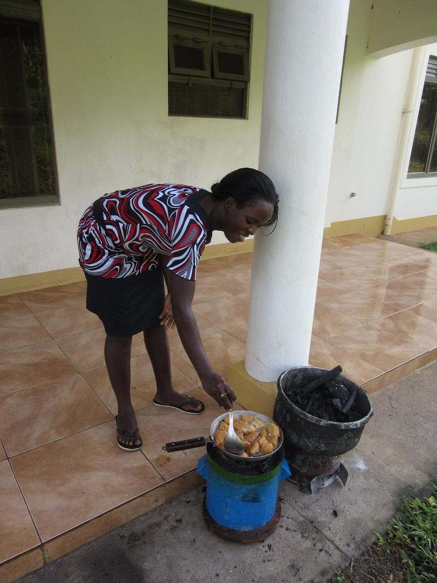 Teddy frying the Mandazi