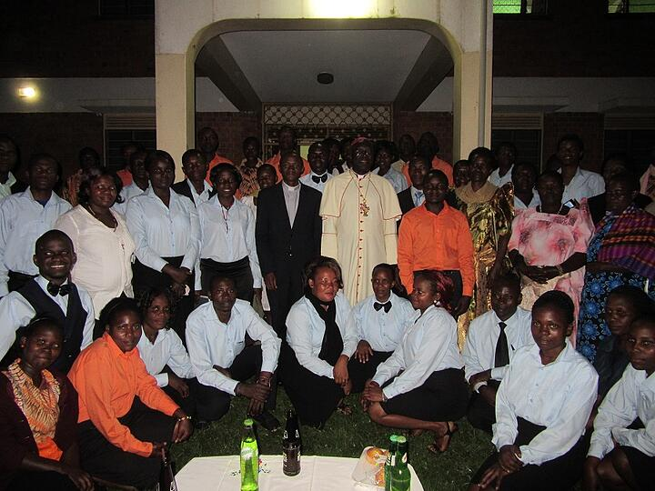 It was a bit dark, but we did manage to get a group photo at the end. Fr. JohnBosco is standing next to Bishop Kakooza.