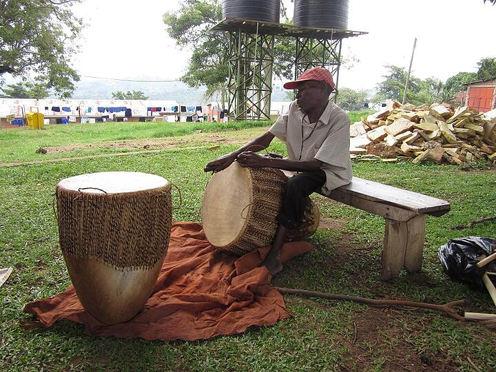 A local artisan repairs drums at Stella Maris Secondary School, where many supporters of CARITAS sponsor a child.