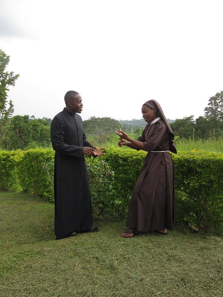 Sr. Carolyne, CARITAS Program Coordinator-Nkokonjeru, and Frank discuss necessary home visits for candidates of our Catholic child sponsorship programs.