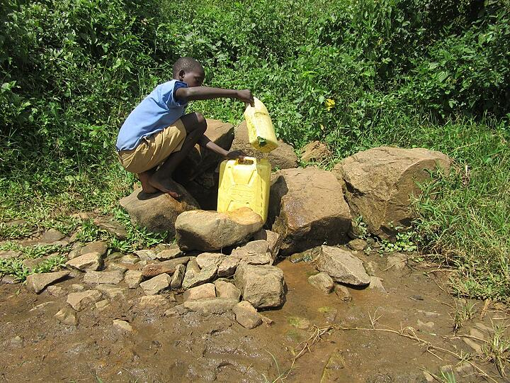 """The """"well"""" is more or less a muddy little river that bubbles out from between a few rocks."""