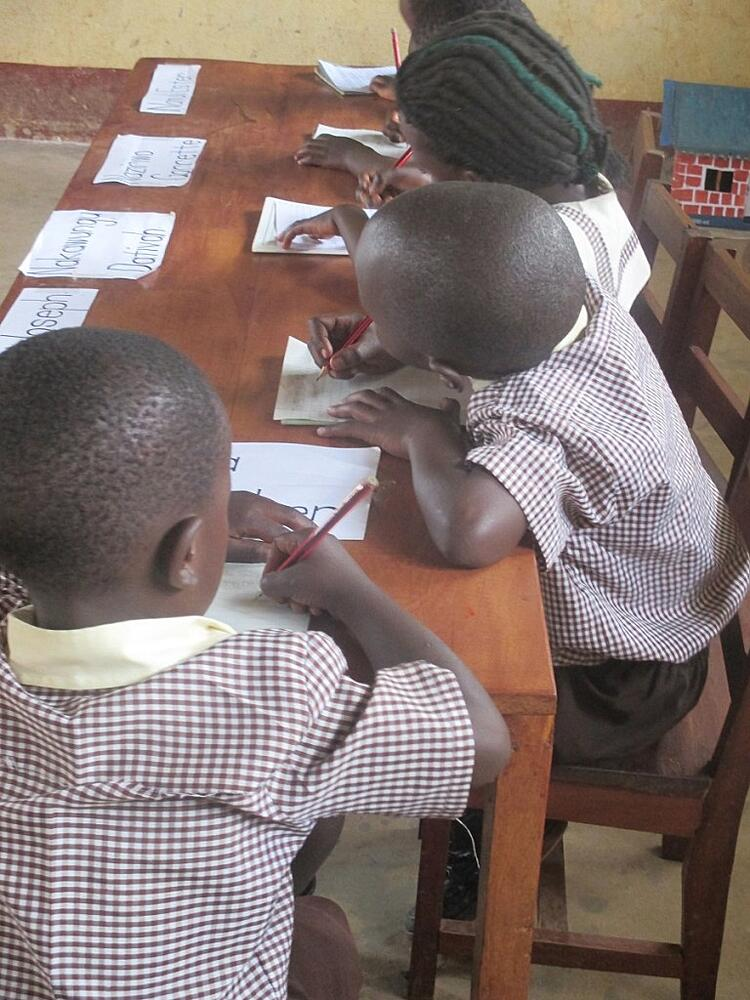 Children_learning_to_read_and_write