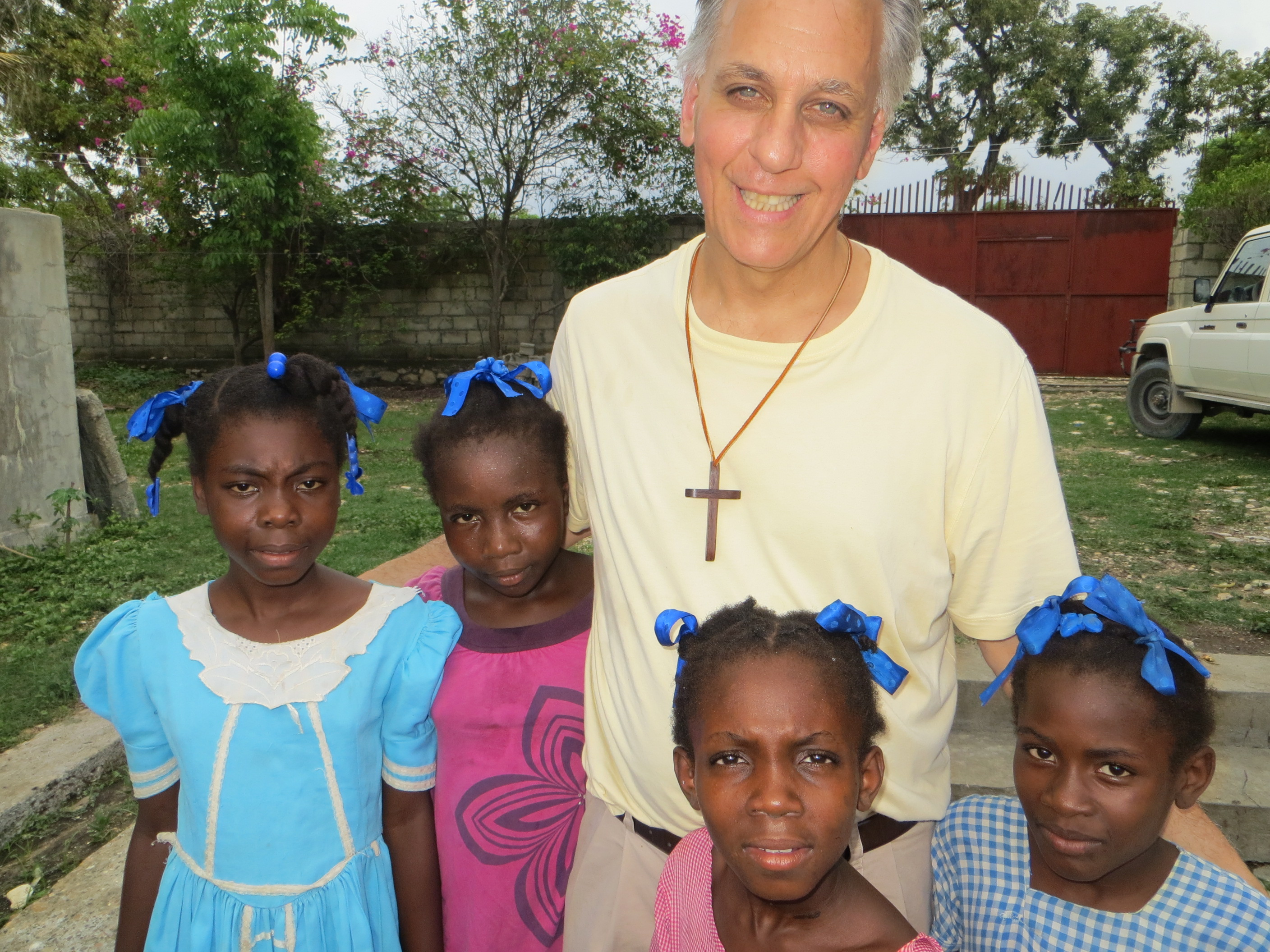 Fr. LoBianco with children from CARITAS child sponsorship programs
