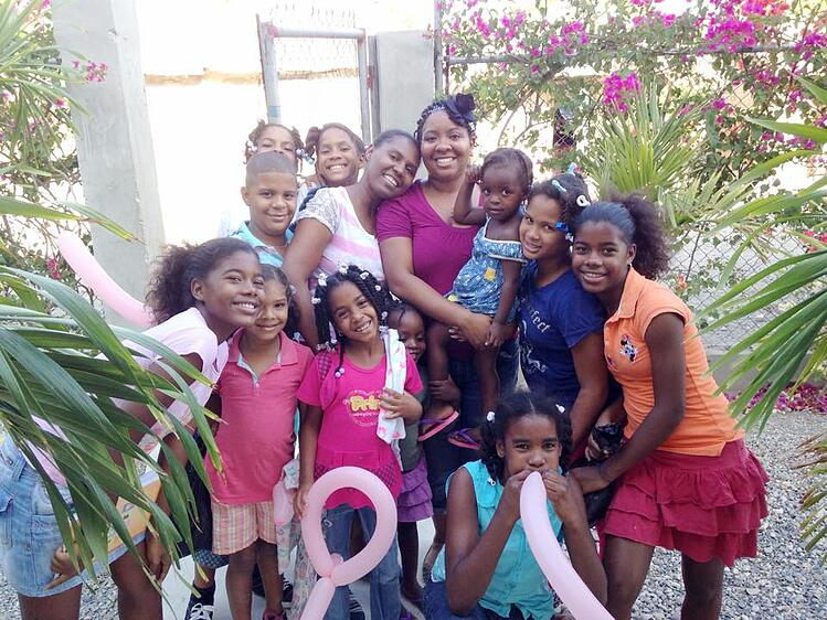 Farron with children in the DR
