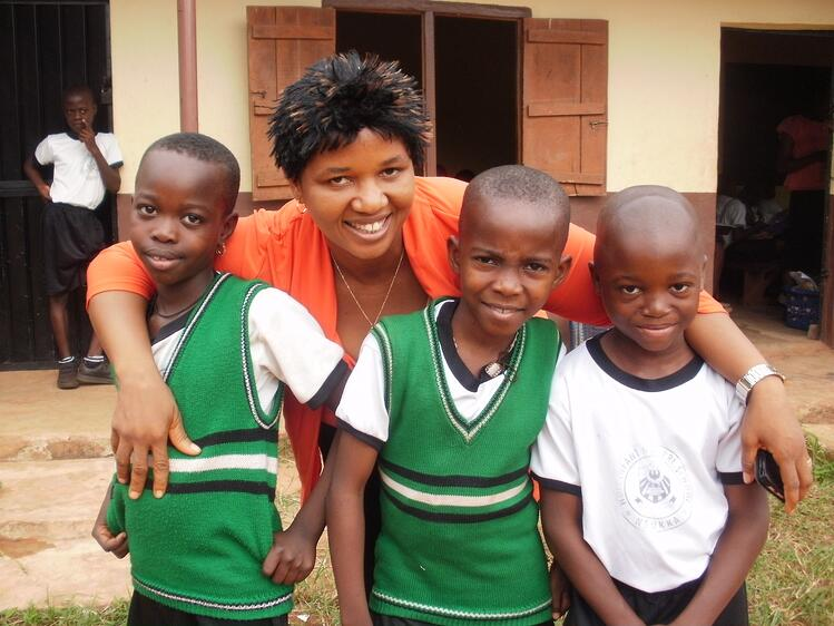 Catholic child sponsorship programs location coordinator with students