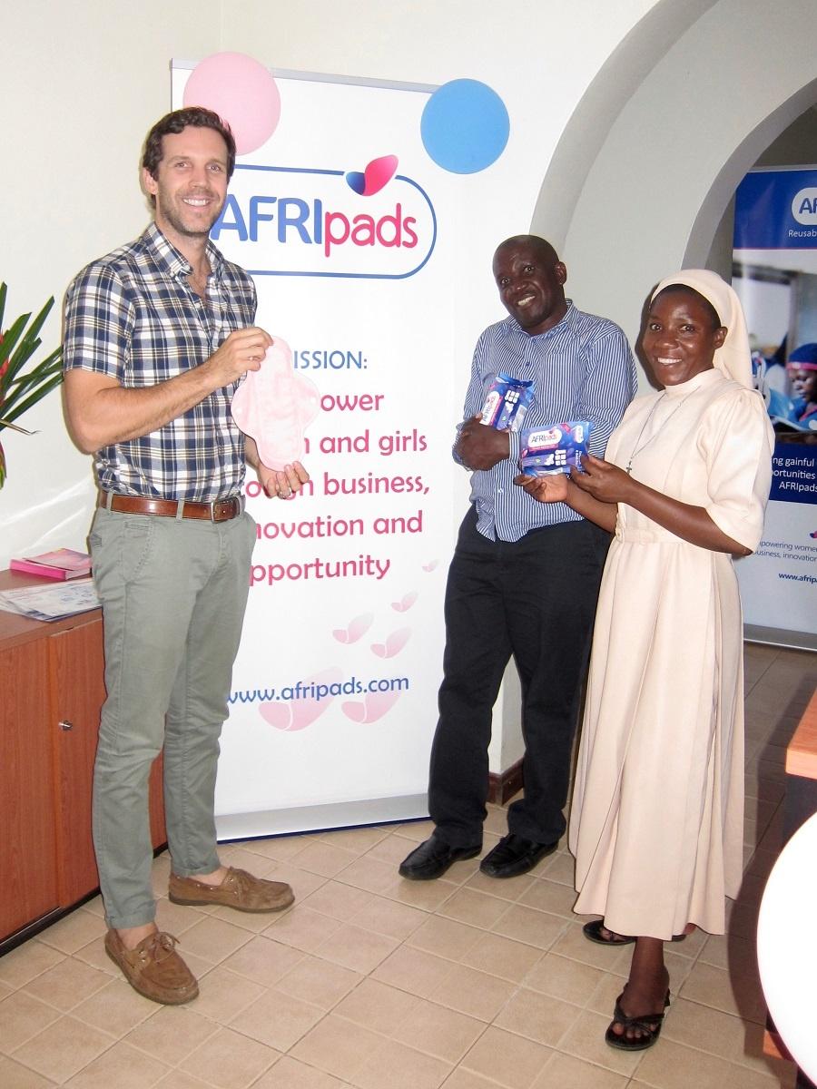 afripads founder with Joseph and Sister Carolyne.jpg
