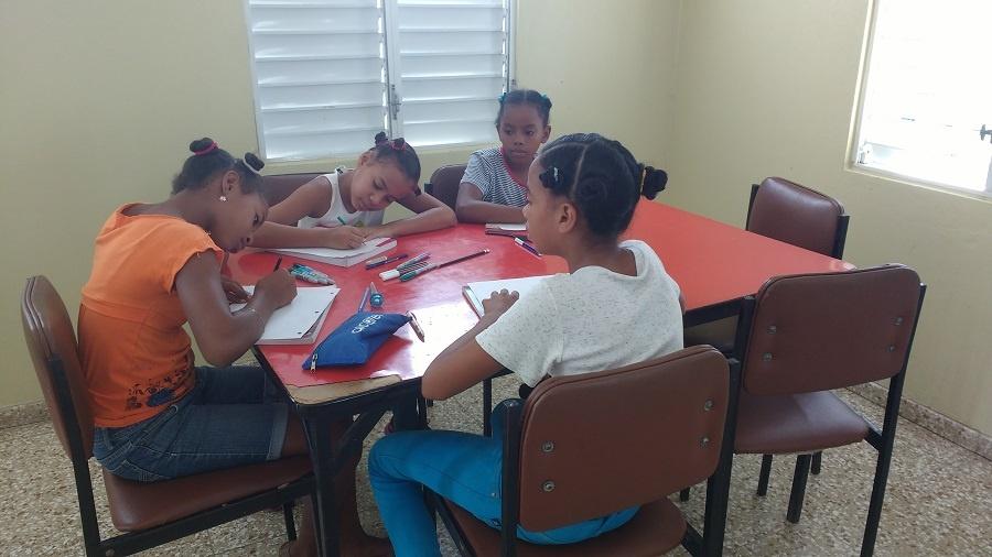 girls writing letters to sponsors.jpg